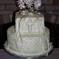 Baptism Cake 2 Tier Baptism cake. White Buttercream icing with green accents. Cross and daisy's around border were done from fondant and dusted...
