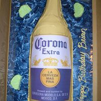 "Corona Bottle Corona Bottle. Used 3 6"" rounds cut in 1/2 and laid on board to create round bottle shape. Used teddy bear pan heating core for bottle..."