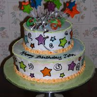 Cosmic Stars Birthday Cake Two tier cake, buttercream icing marbled with different neon colors. Fondant stars on top. Tinted piping gel for designs on sides of cake...