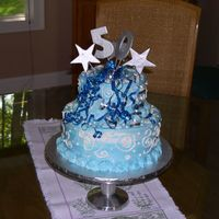"50Th Birthday Cake Two tier cake. Customer did not want any reference to ""over the hill"". Marbled blue & white buttercream. Silver accents -..."
