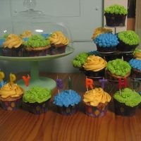 "Blue, Yellow, And Green Cupcakes Here's how the entire display looked. Later my guests used the letter candles to spell out ""Bath Yard Hippy"" so everyone..."