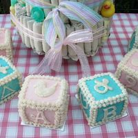 Pink & Blue Baby Blocks Cakes This was the show-stopper at our friends' recent baby shower/party! Two 9x13 cakes: one Cherry Chip dyed pink and one White dyed blue...