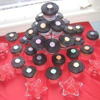 Record Cupcakes For A Rockstar Baby Shower Another view of the record cupcakes I made for a Rockstar baby shower that I co-hosted. There are a couple flavors of cake and I used black...