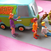 Mystery Machine (Scooby Doo) 3D Cake Mystery Machine 3D cake. Covered in buttercream and fondant accents. With Scooby and the gang action figures.