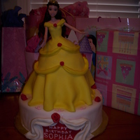 Belle Cake bottom white cake, top strawberry cake with strawberry filling and fondant on top. thanks for looking! :)