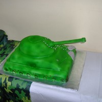 Tank Cake yellow cake with lemon curd filling and fondant on top. airbrushed camo . thanks for looking! :)