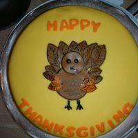Thanksgiving Turkey Cake   Wilton class 4 sample cake turned into a Thanksgiving turkey cake. Fondant with some gumpaste mix, edible markers and luster dust