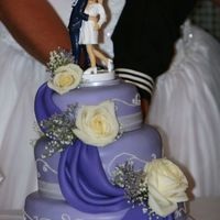 Sailor Wedding Cake  This is a cake I made for my friend who was getting married during a deployment. The wife wanted a fondant purple cake and left the rest up...
