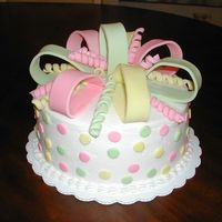 "Bow Cake 2 layer 10"" round, buttercream, fondant bow and polka dots"