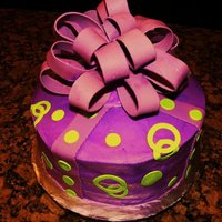 Purple And Green Fondant bow and accents over buttercream