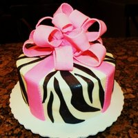 Pink Zebra Stripe Fondant bow and zebra stripes over buttercream