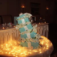 Wedding At Tiffany's This is a wedding cake that I did for my cousin's wedding in August. She wanted a topsy turvy cake with a Tiffany's theme. Thanks...
