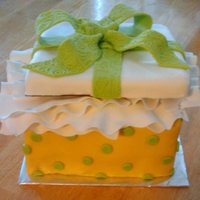 Surprise! :) My mom needed a cake to take to work, and I wanted to try something new. gumpaste tissue paper, RKT lid, lemon cake with fresh homemade...
