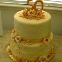 50Th Wedding Anniversary I loved making this cake! fondant roses dusted with shades of gold luster dust, along with fondant flowers, all MMF with a marble cake and...