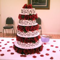 Bounteous Love 4 tier wedding cake. Bottom layer was white, 3rd layer was carrot, 2nd layer was red velvet and top layer was italian cream cake.