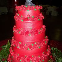 Red Rose Wedding Cake 5 Tier Red wedding cake decorated with lots of roses around each layer.