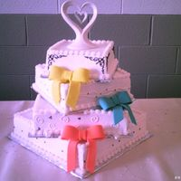 Square 4 Tier Wedding Cake This is a 4 tier cake decorated with buttercream icing and bows are made out of fondont. This was my first square wedding cake that I have...