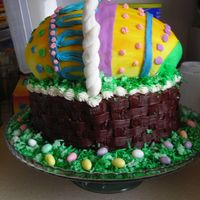 "Easter Basket Cake The basket is 3 layers of yellow cake (9"" I believe) decorated with canned chocolate frosting. The handle is MMF wrapped around a wire..."