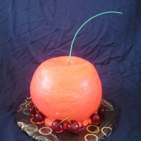 "3D Cherry Cake CSM: I made this for a friend's birthday. He LOVES cherries. This was my first carved cake. I used 3"" of 8"" layers..."
