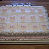 Brandys_Baby_Shower_05.jpg   scored cake with pink baby booties for my best friends baby shower