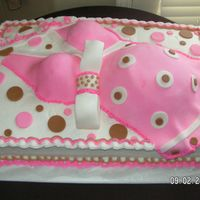Pregnant Belly Cake I took ideas from two different cakes I found on this web site and created this belly cake for a couples baby shower. Cake was iced with...