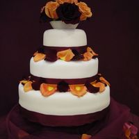 Orange And Purple The top two tiers were lemon with strawberry filling, the bottom was white with raspberry filling.