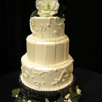 "Fondant Accents  These are 12"", 10"", and 8"" styrofoam dummies for a wedding show. the cakes are covered in buttercream frosting and accented..."