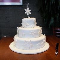 Winter Wedding  This cake features handmade and pre-made snowflakes on a clean ivory background. Fondant cakes, pastillage snowflakes with royal icing...