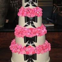 Multi Flower Wedding Cake There were 862 individual airbrushed flowers on this cake between the 4 seperated tiers. Bows were done with florist ribbon and I used a...