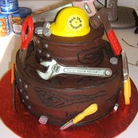 "Rob The Builder Cake for my neighbor who we jokingly call ""Rob The Builder"". Tools are molded chocolate painted with silver luster dust. Hardhat..."