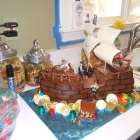 "Pirate Ship Cake For my son's 5th Birthday Paaarrrrrty! Two 9x13 cakes and one 8"" round cut and stacked to look like pirate ship. I found Capt...."