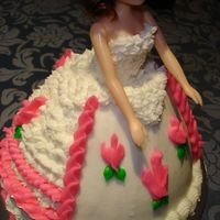 Dolly Varden Doll Cake second cake we made in class. I hate this one. It's just UGLY and I was introduced to the dreaded 104 tip for ruffles. I finally got...