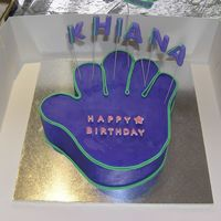Hi-5 Cake Choc fudge cake Hi-5 hand covered w/ purple bc and green fondant detail. Name and number made out of fondant with CMC added. I carved it...