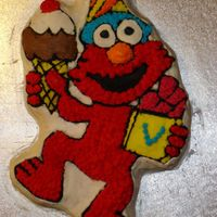 Elmo Cake The catalyst that drove me to classes. This Elmo looked like he was possessed by dark forces. It's just BAD BAD BAD. The kids at my...