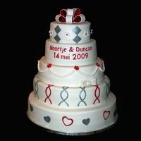 White, Silver And Red Wedding Cake   Same colors as the wedding invite and dress.covered and decorated with fondant.