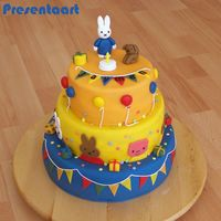 Miffy Cake 3 Layer   spongecakes filled with nutella bc and cherry-jan.Covered with fondant. Miffy and decorations also made of fondant.