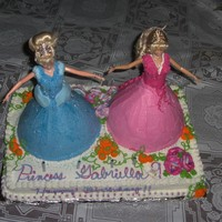 Princess Birthday Cake This was my daughter's birthday cake. We used an 11x18 sheet cake and wonder mold pan for the dolls. Everything else is buttercream...