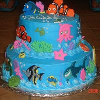 My Nephew's Nemo Cake   This is my first stacked cake. It has buttercream icing and all of the characters and sealife are color flow. Let me k now what you think