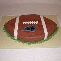Carolina Panthers Football Cake This was a groom's cake. It's a 12X18 sheet carved into a football with a chocolate transfer for the Panthers logo. The cake was...