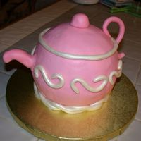Pink Teapot  This was my first attempt at a teapot. I did it for my MIL's birthday. Cake is French VanillaWASC, with strawberry BC. Strawberry MMF...
