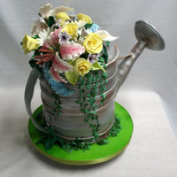 Watering Can The flowers are gumpaste, as are the details on the can-with a dowel to support the spout. Airbrushed in silver and bronze and brown, and...