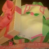 Onesie Gift Box My first box cake and I was very pleased with the results, the lid is gumpaste as is the tissue, the rest is covered in fondant. I took...