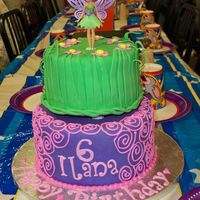 Tinkerbell Cake My first time using SPS, I loved it, but apparently leveled too much off my cake because there was a gap. I didn't care though,...