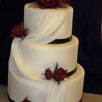 Ribbon, Drapes And Roses Dummy cake that I mde for my open house. I was SO pleased with the outcome! :) satin ribbon, silk roses. iw as going to use gumpaste, but...