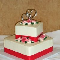 Square With Ribbon Just a little tiered square cake with ribbon.