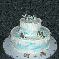 Penguin Winter Cake Snowflakes were royal icing, and the penguins were modeled from fondant. It you look closely, you can see one of the penguins with a...