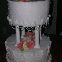"Wilton Course 3- Fondant Tiered Cake  this is actually a tiered cake made out of 8"" and 10"" cake dummies, covered in BC to hold down Fondant and then decorated with BC..."