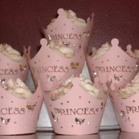 Princess Cupcakes Simple yellow cupcakes with buttercream frosting and sprinkles. I baked them in silver foil cups to really make the pink wraps pop. I found...