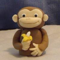 "Curious George George is made from fondant. My favorite part is the little banana in his hand :) The bananas are ""Runtz"" and I painted the ends..."