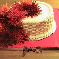 Fall Flower Cake White and chocolate layer cake with chocolate buttercream filling. The flowers on top are fake.